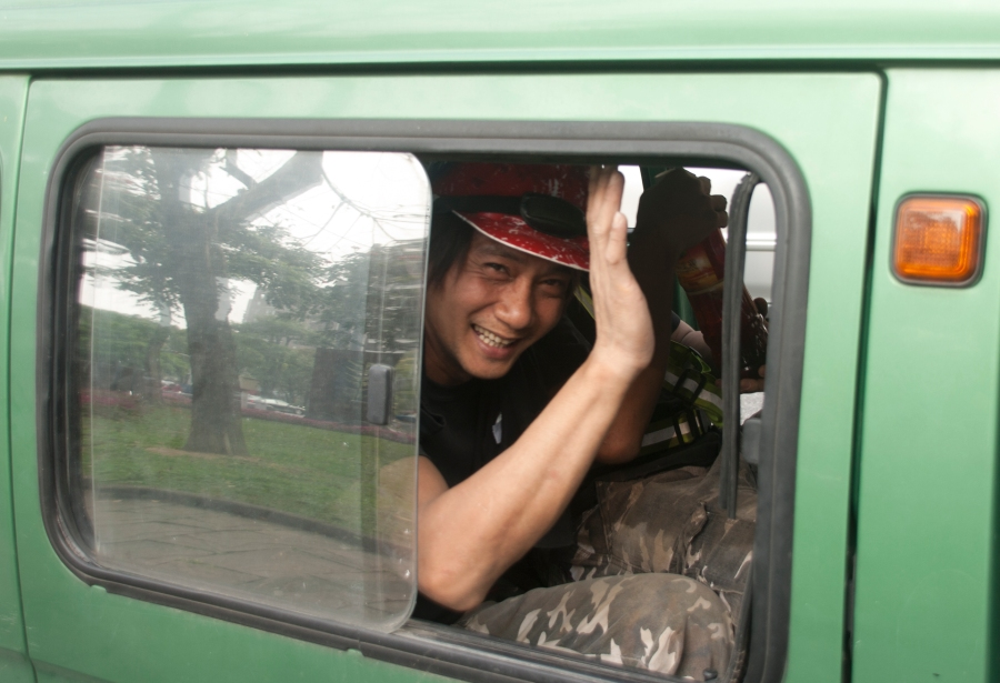 Workmen in mini van saying goodbye