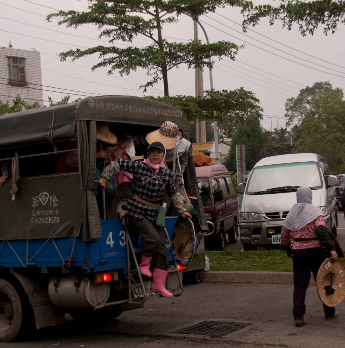 Tea Pickers Getting Off a Truck at the End of the Day