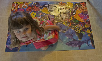 Sarah Sitting on Her Completed Puzzle