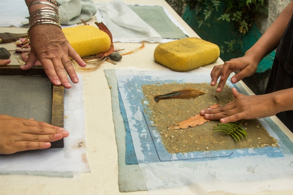 Hands Making Paper