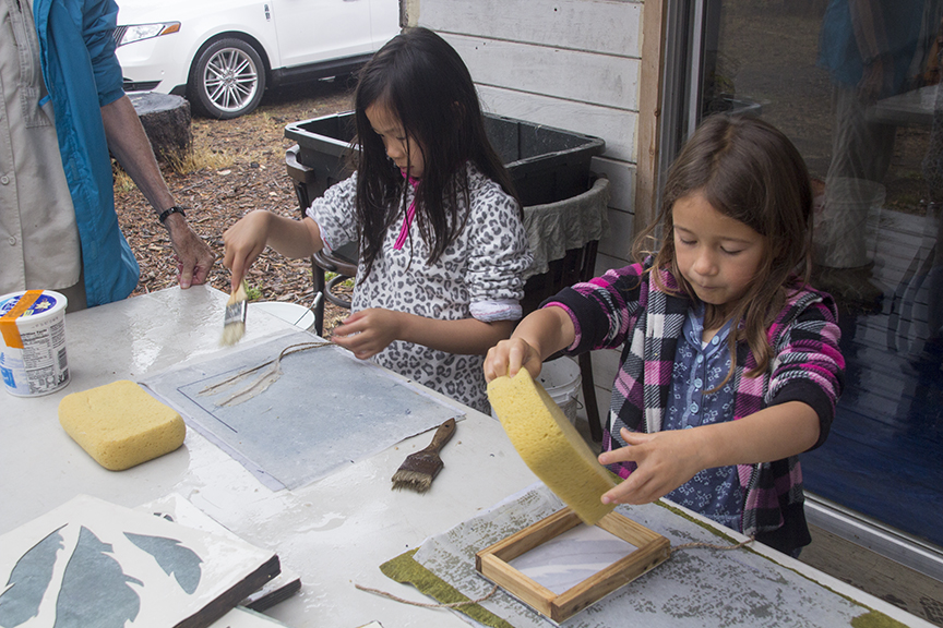 Two Sisters Making Paper