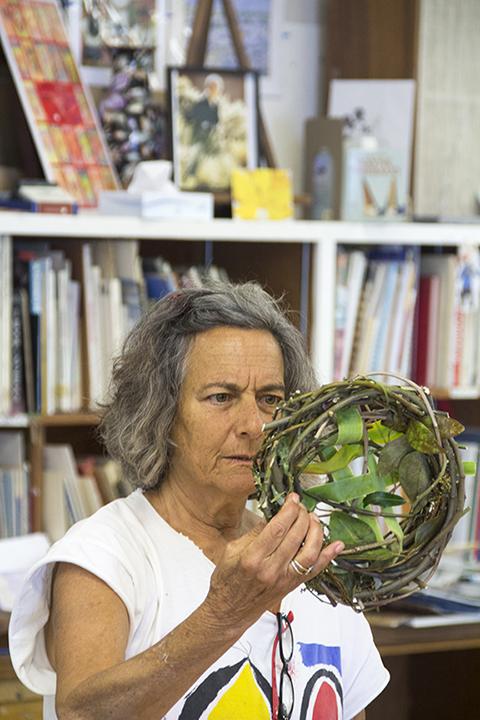 Diana Marto Checking a Small Nest