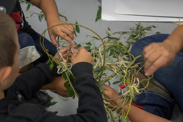 Two Younger Students Making Small Nests