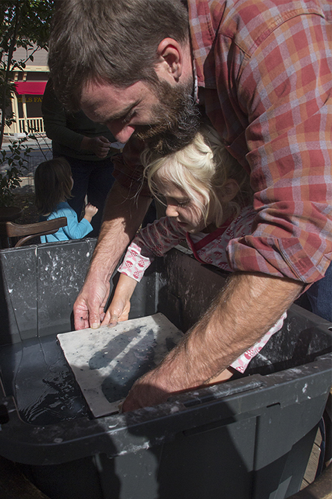 A Father and Daughter Making Paper Together