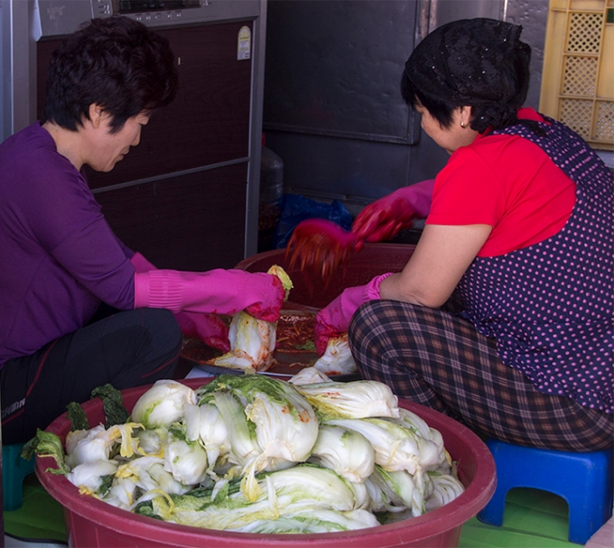 Two Women Cleaning Vegetables