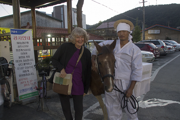 Jane with a Traditionally Dressed Man and His Horse