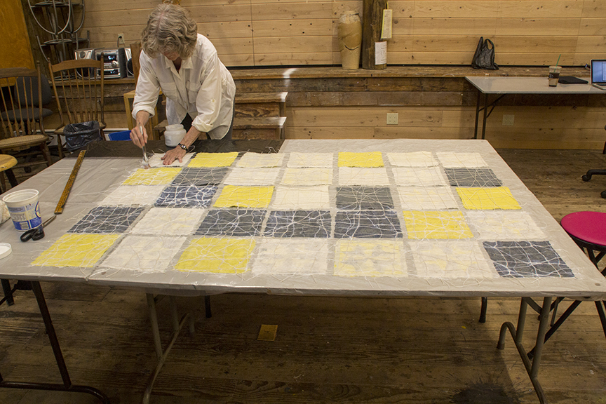 Jane working on paper quilt