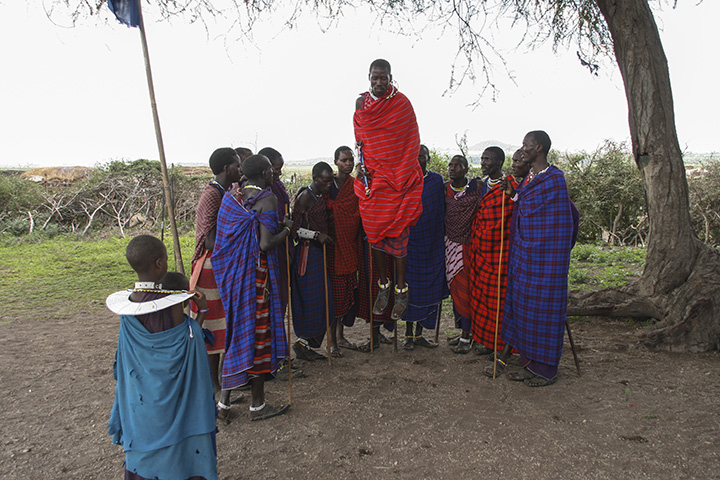 While visiting the Masai village we were entertained with a traditional Masai song where young warriors jumped up and down. He is wearing one of the traditional conga style wraps. As I remember the song was about a lion hunt.