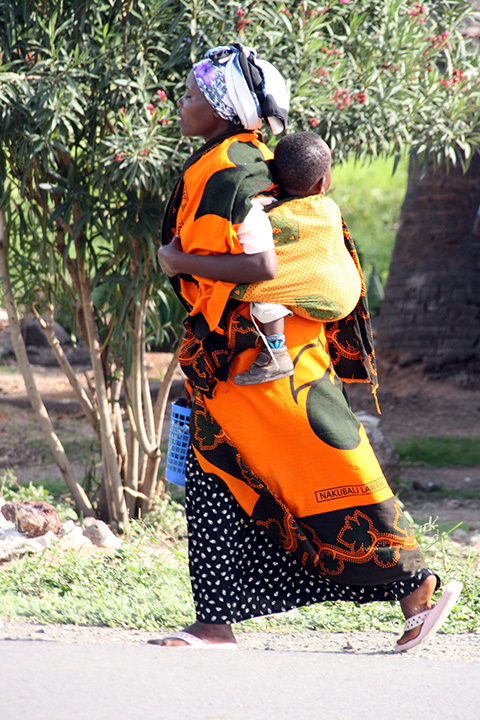 Women Carrying Child