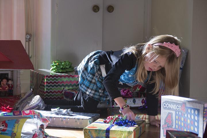 Emily checking Christmas Presents