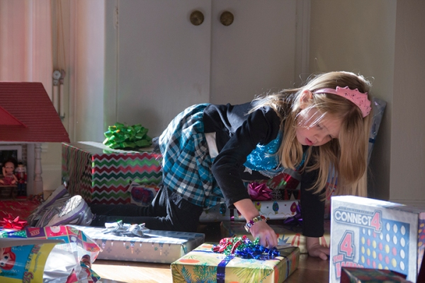 Emily checking Christmas Presents