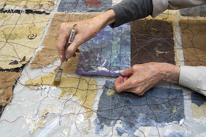 Jane painting her Sitka Site map
