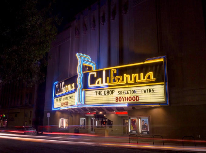 """The Landmark California was built in 1913. It was originally a live stage theatre. The """"Cal"""" is known for its Fleur de Lys motif."""