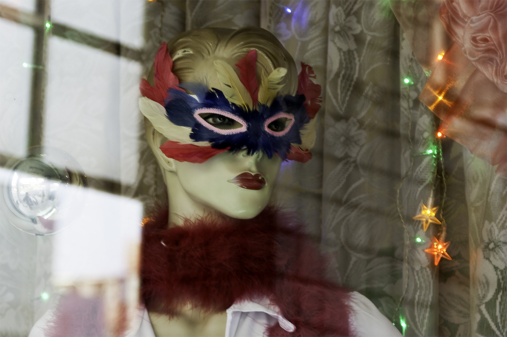 Mannequin in the window of a costume rental store for ballroom dancing located in Taichung Taiwan.