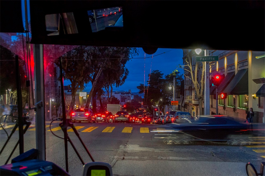 Riding in the front seat of Golden Gate Transit bus 101 headed north from San Francisco at dusk. Looking down Van Ness toward the SF Bay.