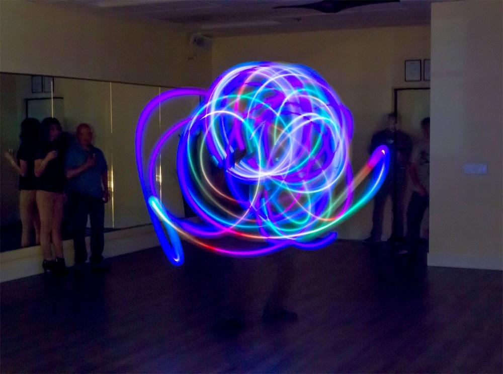 Kona Waha Santa fire dancing at the Grand Opening of Vibe Voga in Santa Rosa, CA, January 31, 2015.