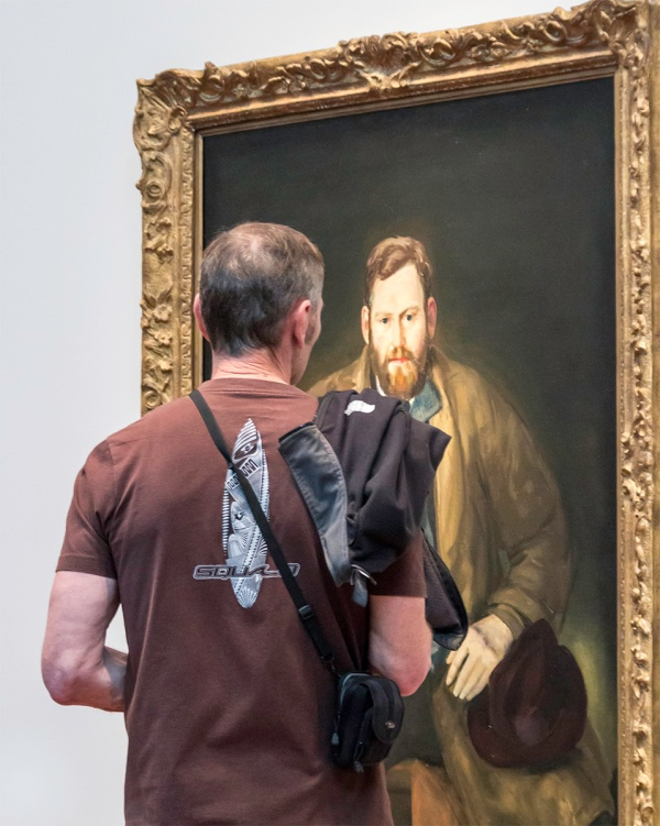 A visitor to the de Young Museum looking at a portrait of Waldo Peirce by John Wesley Bellows, 1920. Photo taken February 2015