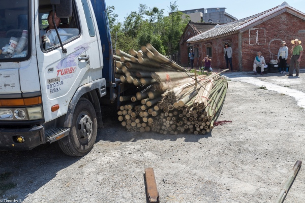 Mr Ye makes his delivery of bamboo to House 100 for artists to use for their projects. Cheng Long Wetlands International Environmental art Project, 2015. April 13, 2015