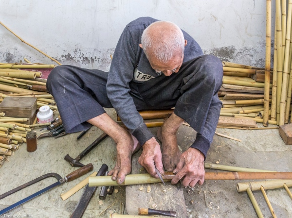 Bamboo Master uses his feet as a vice.