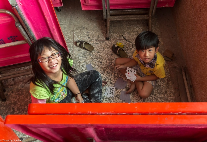 Two children caught playing cards in the temple. April 18, 2015