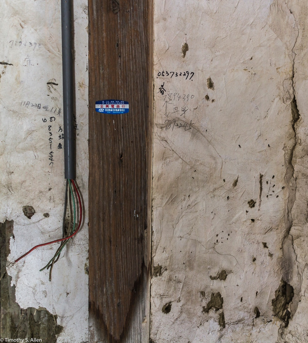 Phone Wall in an Abandoned Traditional House in Chenglong Village, Taiwan April 25, 2015