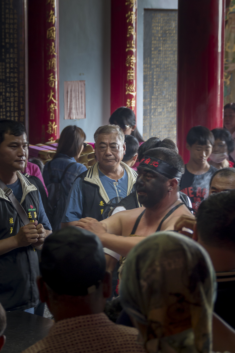 At the temple's altar the Tangji or possessed visitor begins to communicate with the god of the Cheng long Village temple. April 24, 2015