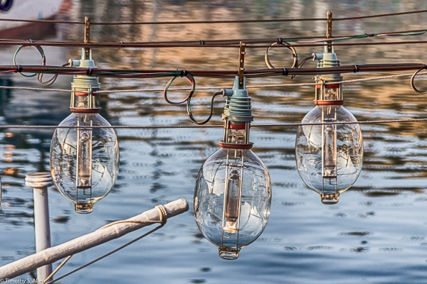Three of Hundreds of Lights Used on Fishing Boats in Badouri Fishing Harbor, Keelung City, Taiwan May 29, 2015