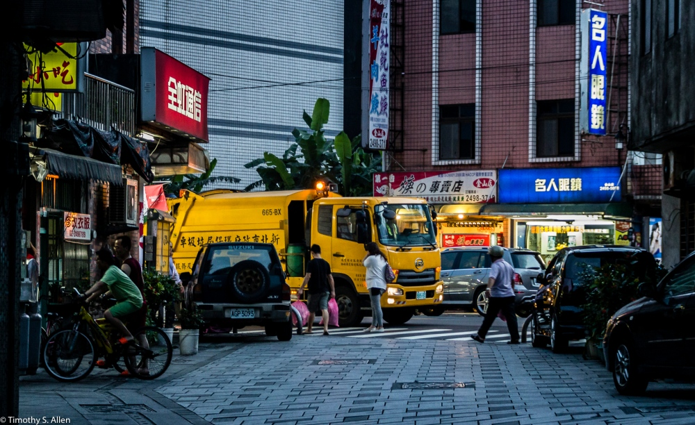 """Taiwan Garbage Trucks Call People to Bring Their Garbage to the Truck by Playing """"Fur Elise"""" from Beethoven. Gold Mountain Village, Taiwan May 18, 2015"""