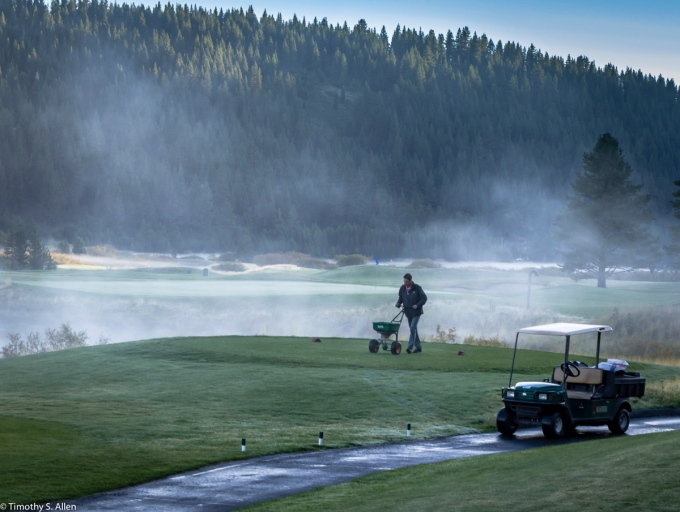 Caring for the greens, Resort at Squaw Creek, Olympic Valley, Lake Tahoe, California, USA August 17, 2015