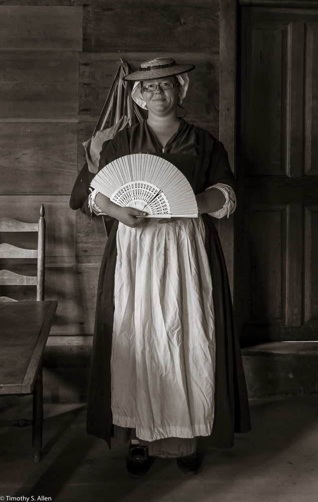Jen Burns, a National Park employee in 1775 period clothing at the Hartwell Tavern, Lincoln, MA. August 29, 2015 A Park Ranger joining with the The Lincoln Minute Men volunteers. She is dressed in 1775 period clothing at the Captain William Smith House, Lincoln, MA. She would represent on of the towns-people from the town of Lincoln. August 29, 2015 For more information on the park, go to http://www.nps.gov/mima/index.htm