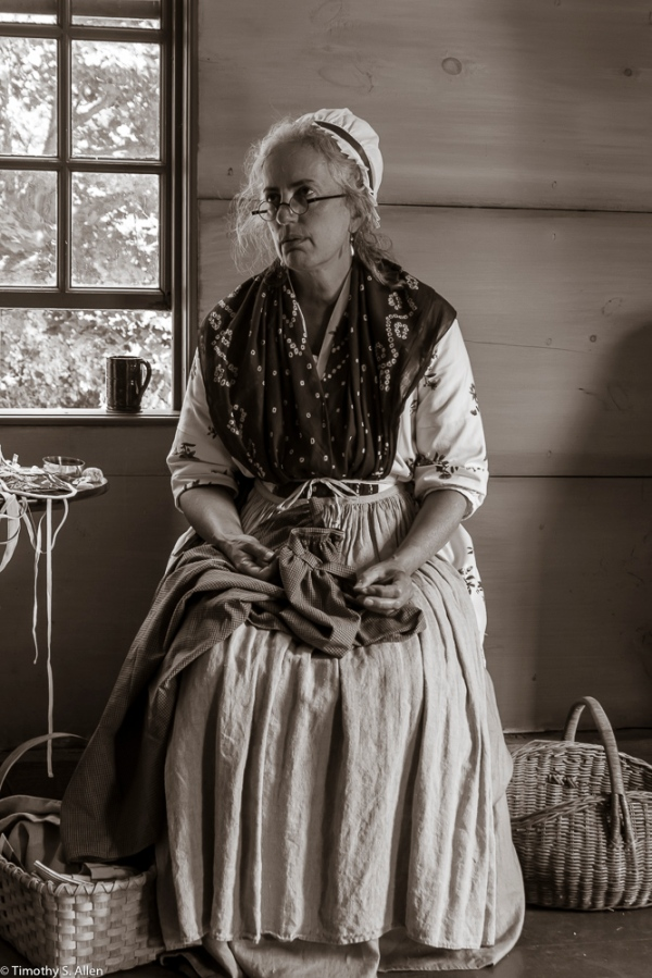 One of The Lincoln Minute Men volunteers dressed in 1775 period clothing at the Captain William Smith House, Lincoln, MA. She would represent on of the towns-people from the town of Lincoln. August 29, 2015