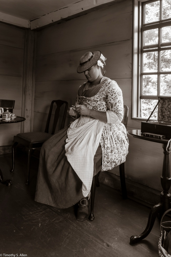 A Park Ranger joining with the The Lincoln Minute Men volunteers. She is dressed in 1775 period clothing at the Captain William Smith House, Lincoln, MA. She would represent on of the towns-people from the town of Lincoln. August 29, 2015 For more information on the park, go to http://www.nps.gov/mima/index.htm