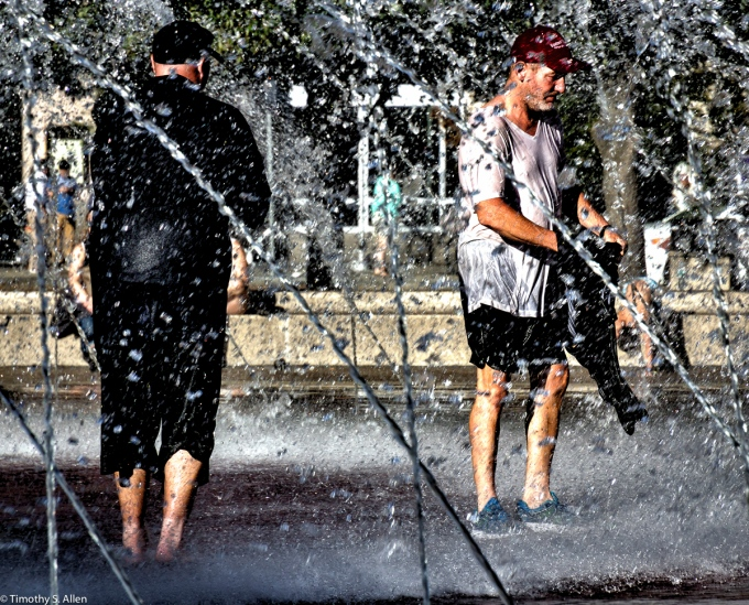Homeless washing and bathing in the Christian Science Fountain, Boston, MA, USA. August 27, 2015