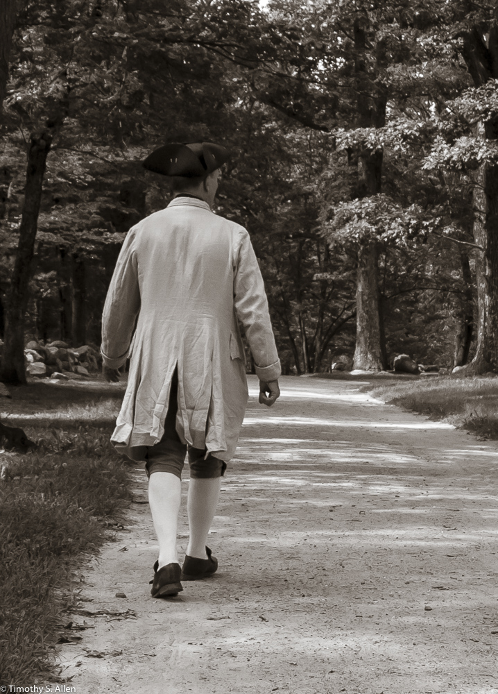 Ed Wilder, Park employee walking down the road where the British troops were fired on by the Minute Men, Minute Men Nationa Historic Park, Lincoln, MA, USA August 29, 2015 For more information on the park, go to http://www.nps.gov/mima/index.htm