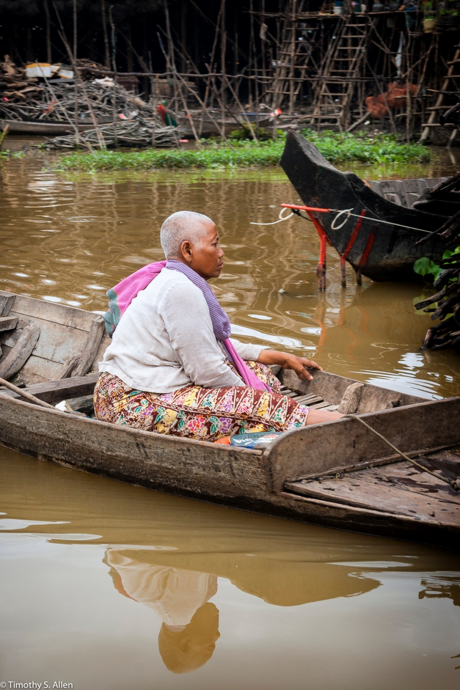 Older Women Floating in a Boat Cambodian Village on the Water January 17, 2012
