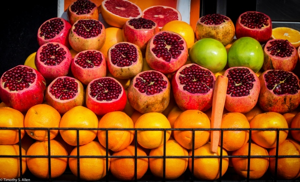 Fruit Stand with Pomegranate, Apples, and Oranges Istanbul, Turkey November 24, 2015