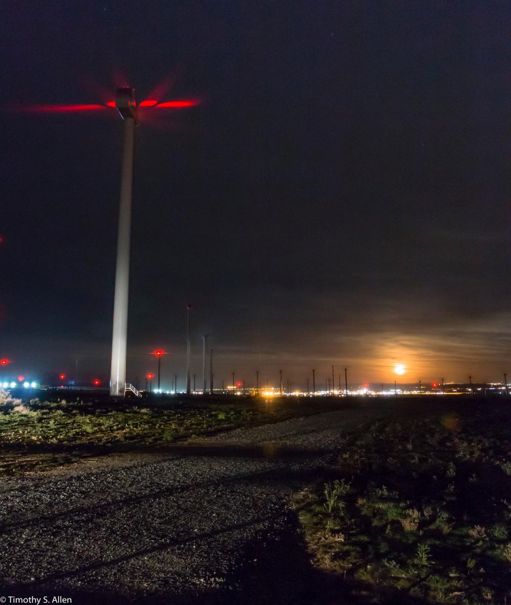Moon Rising Among the wind Turbines