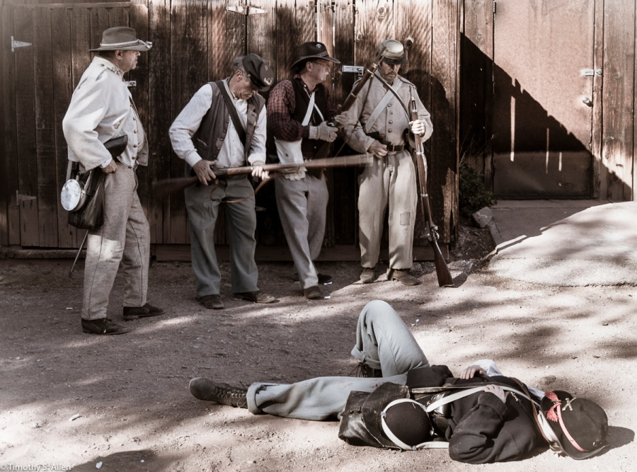 Civil War Reenactment, Four Members of the 7th and/or 8th Louisiana Infantry Regiment Pause to Take Stock After Shooting a Union Soldier, Calico Ghost Town, California, U.S.A. February 15, 2016