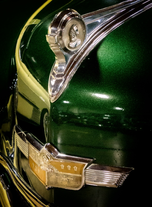 Hood Ornament and Emblem 1949 DeSoto Carryall Sedan - '49 Cadillac Reflected in the Hood California Automobile Museum – http://www.calautomuseum.org – Sacramento, California, U.S.A. – March 31, 2016