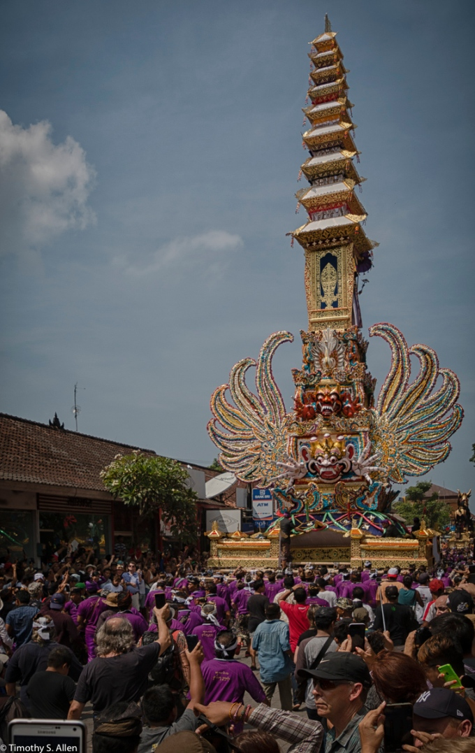 Cremation of the Ubud Bali Royal Family Member Cokorda Putra Widura. The backside of the cremation tower is being carried by palace men down the street toward the cemetery where the cremation will take place. Ubud, Bali May 7, 2016