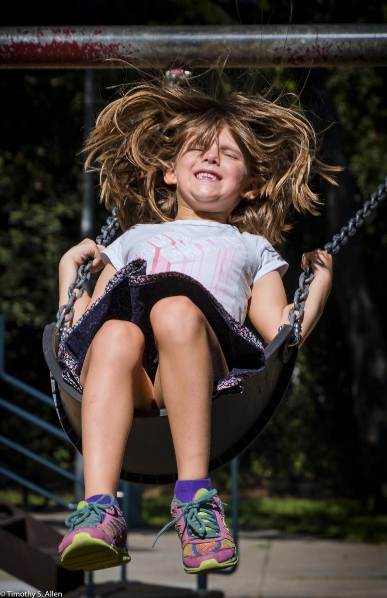 My Granddaughter Sarah Flying High on a Swing Santa Rosa, California, U.S.A. July 2, 2016