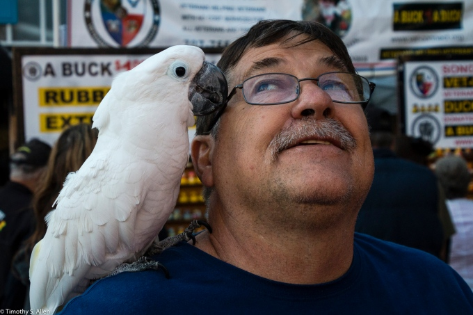 """John Lloyd is the CEO of the non-profit """"Birds of a Feather Rescue"""", http://www.birdsoafeatherrescue.org Downtown, Wednesday Market 4th Street, Santa Rosa, CA, U.S.A. August 3, 2016"""