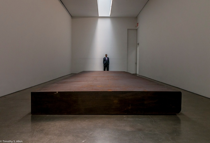 """Security Guard Looking Over the Sculpture by Richard Serra, """"Silence"""" forged steel is 29.5′ x 9′ x 2′ weighs 80 tons. Gagosian Galley, 522 West 21st St, New York - September 16, 2016"""