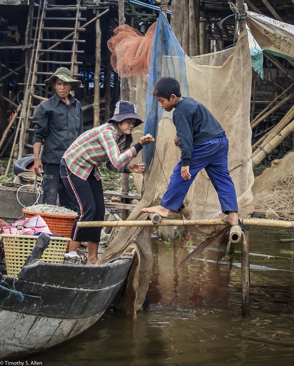 Repairing Nets Tonli Sap Lake Floating Village, Cambodia January 19, 2012