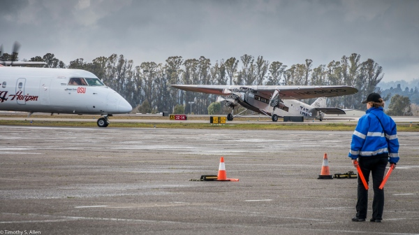 Alaska Airlines Bombardier Q400 Crosses in Front of EAA's Ford Tri-Motor Aircraft. Santa Rosa Airport February 4, 2017