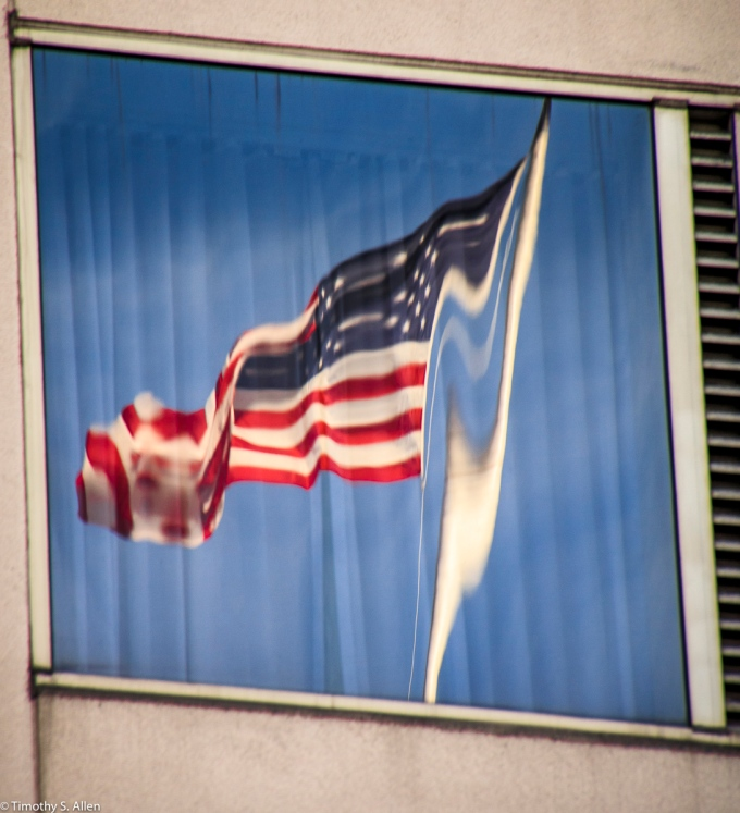 A Reflected View of the American Flag Atop a Building San Francisco, CA February 24, 2017