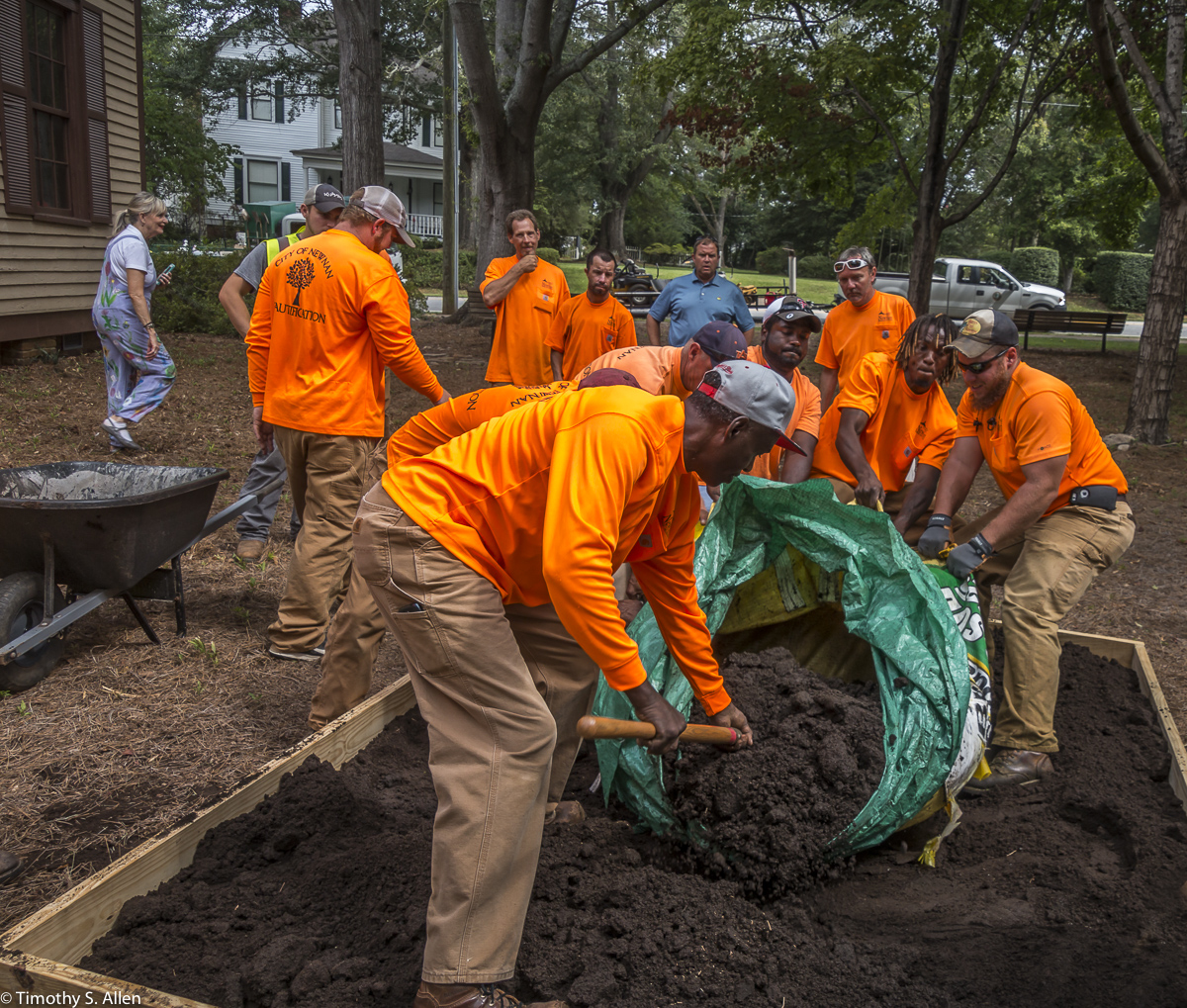 City of Newnan Crew Dump Dirt on the Site of Jane Ingram Allen's Newnan Art Rez Eco Art Quilt. It Is Located at Veterans Park Outside of the Men's Academy School Newnan, GA, U.S.A. August 25, 2017