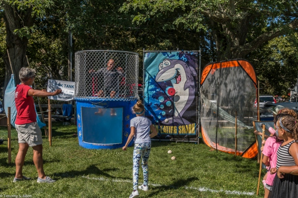 Elementary Student Successfully Hits the Target to Dunk Her Elementary Principal Eastham Windmill Weekend Eastham, MA, U.S.A. September 11, 2017