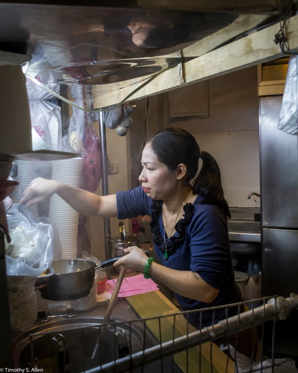 Preparing Noodle Dishes for Her Customers Taichung, Taiwan April 17 2014