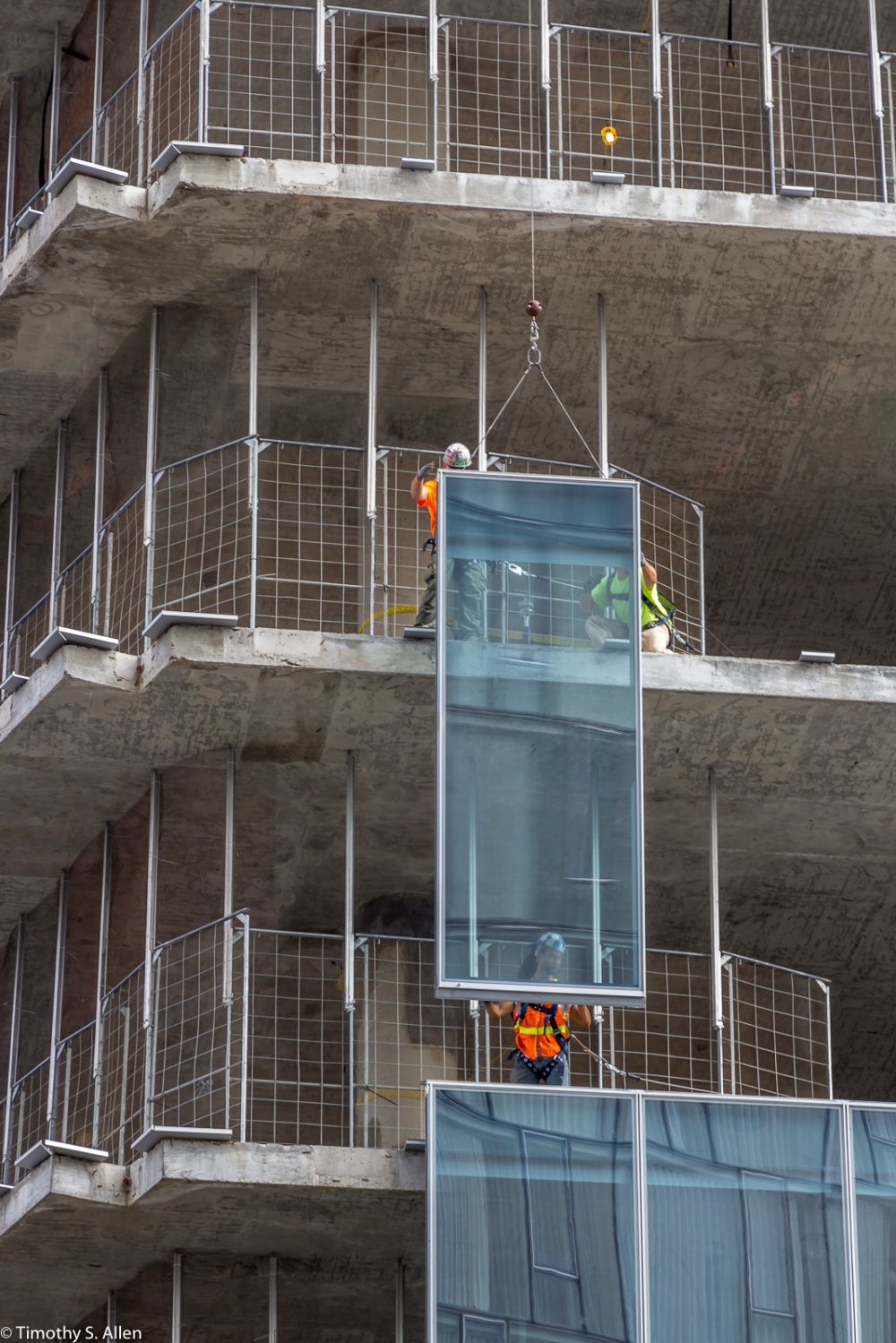 Installing Windows on a Skyscraper Being Built Near the Hudson River. New York, NY September 4, 2015